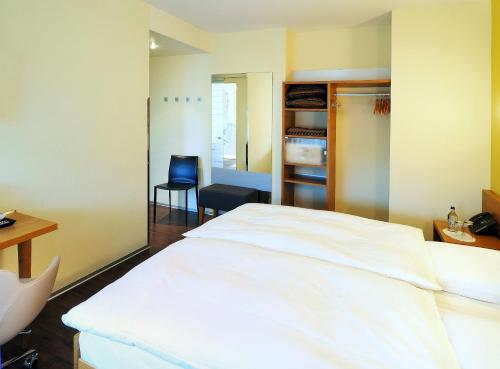 Ein Bett oder Betten in einem Zimmer der Unterkunft Sommerau-Ticino Swiss Quality Hotel