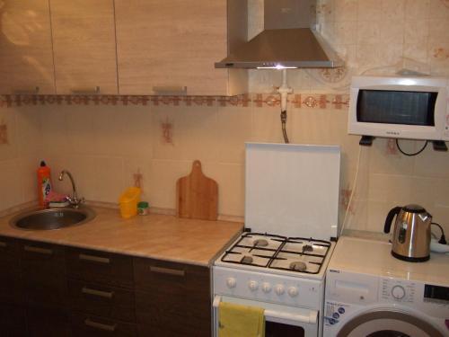 Кухня или мини-кухня в Апартаменты в Люберцы