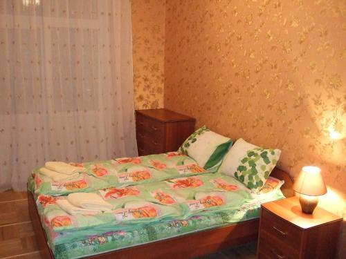 Кровать или кровати в номере Апартаменты в Люберцы