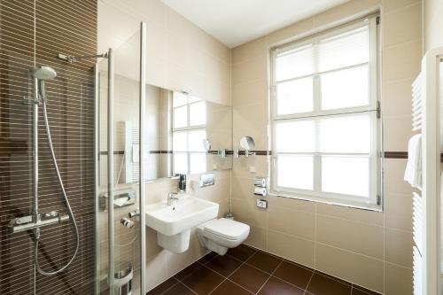 Ein Badezimmer in der Unterkunft Aparthotel Am Schloss