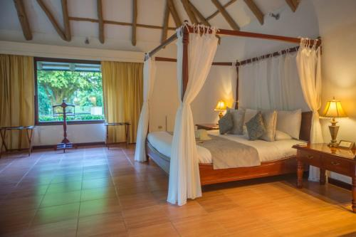 A bed or beds in a room at Royal Palm Galapagos