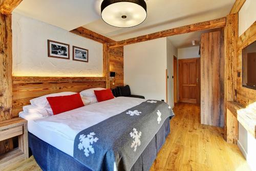 Łóżko lub łóżka w pokoju w obiekcie Hotel Olympie