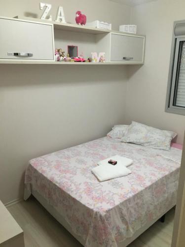 Cama ou camas em um quarto em Apartamento Super Aconchegante