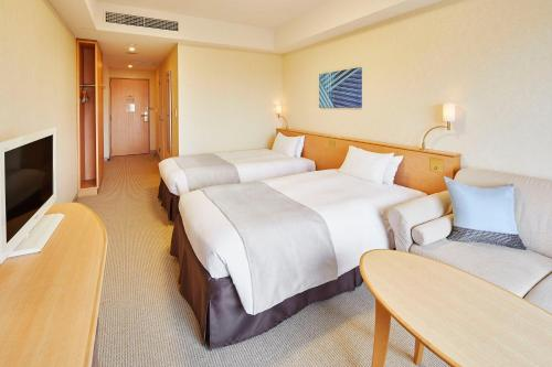 A bed or beds in a room at Hotel Emion Tokyo Bay