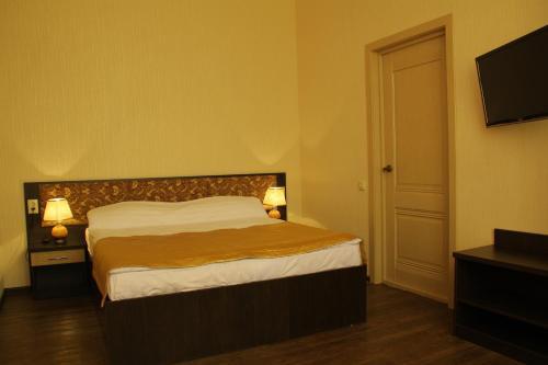 Кровать или кровати в номере Отель «Эстет»