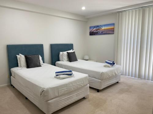 A bed or beds in a room at Mantra Nelson Bay