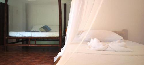 A bed or beds in a room at The Blue Orchid Resort