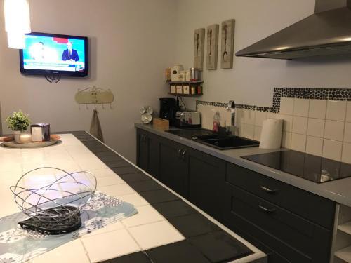A kitchen or kitchenette at Appart'hôtel Le Clos du May