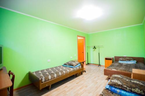Кровать или кровати в номере Гостиница квартирного типа Мира 32