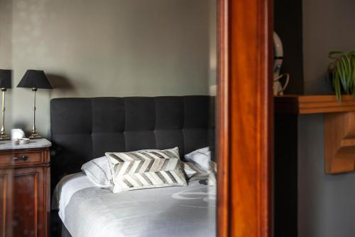 A bed or beds in a room at B&B La Passion Interdite