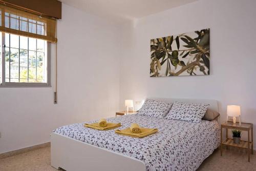 Postel nebo postele na pokoji v ubytování House Pedregalejo Malaga