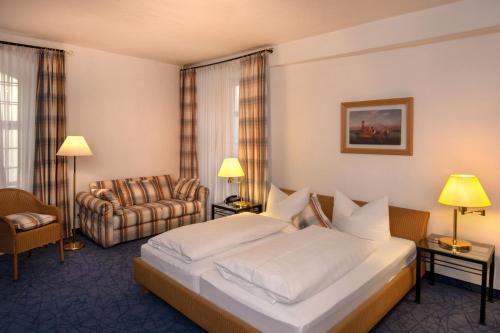 Postel nebo postele na pokoji v ubytování Posthotel Kolberbräu