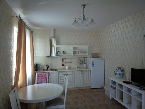 Кухня или мини-кухня в Гостевой дом Корница