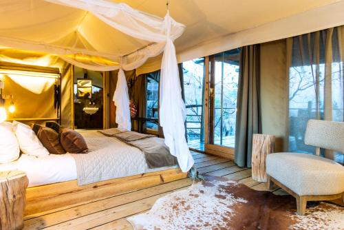 A bed or beds in a room at Erongo Wilderness Lodge