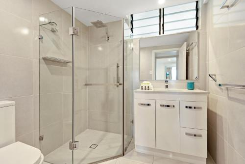 A bathroom at Fully Renovated Frangipani Beach Front Apartments