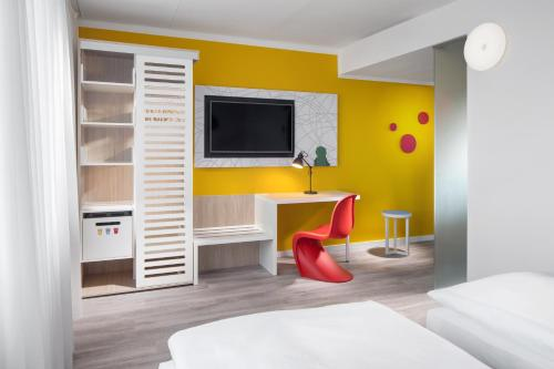 A television and/or entertainment center at Comfort Hotel Prague City East