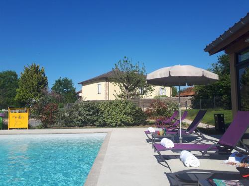 The swimming pool at or near Auberge Bressane de Buellas