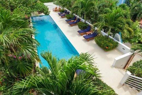 A view of the pool at Weezie's Ocean Front Hotel and Garden Cottages or nearby