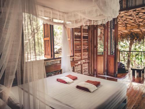 เตียงในห้องที่ Nature Hill