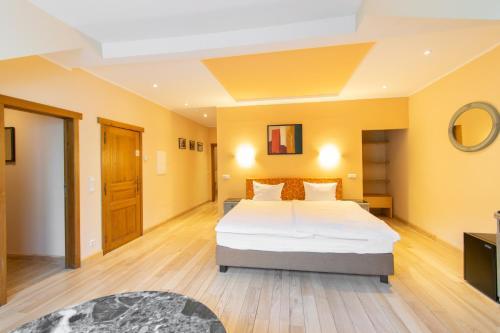 Ein Bett oder Betten in einem Zimmer der Unterkunft Aux Tanneries de Wiltz