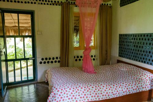 A bed or beds in a room at Evergreen Ecolodge