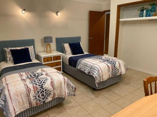 A bed or beds in a room at Miami Tranquility