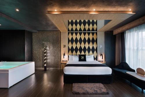 A bed or beds in a room at H Hotel - Adults Only