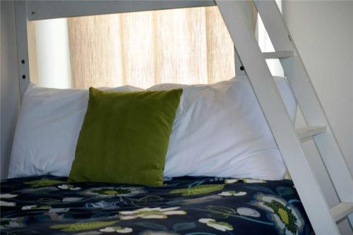 A bed or beds in a room at Big Fish Two-Bedroom Home