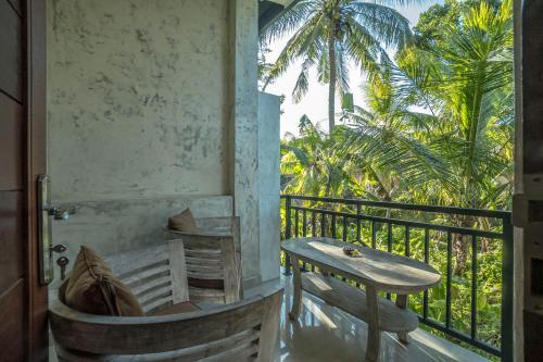 A balcony or terrace at Adi Bisma Inn
