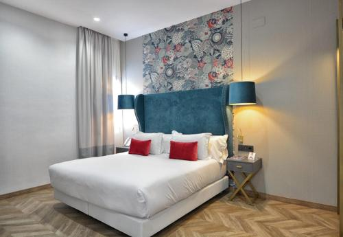 A bed or beds in a room at Soho Boutique Sevilla