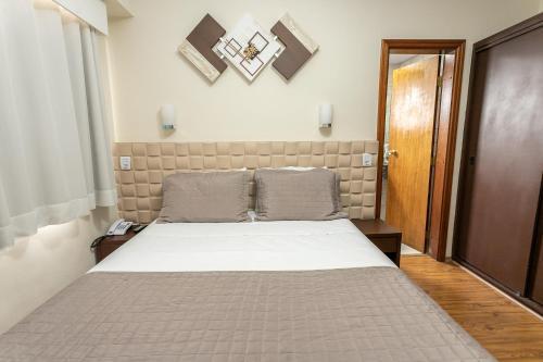 Cama ou camas em um quarto em Hotel Marbor