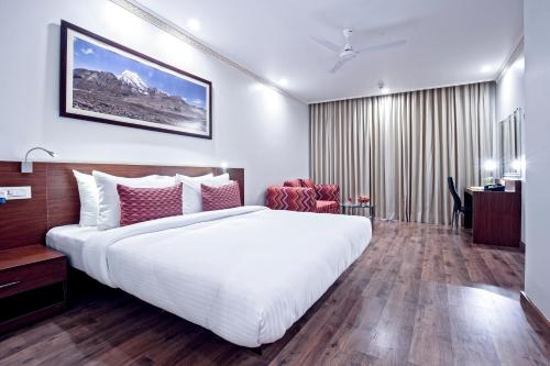 A bed or beds in a room at Lemon Tree Hotel Gangtok