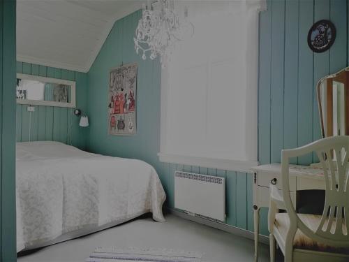 En eller flere senger på et rom på Haugtun gårdspensjonat og leiligheter