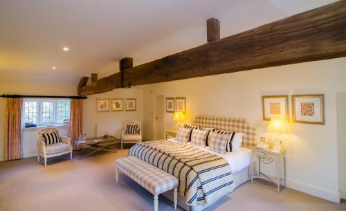 A bed or beds in a room at The Slaughters Manor House