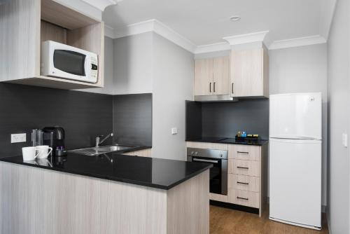 A kitchen or kitchenette at Quest North Ryde
