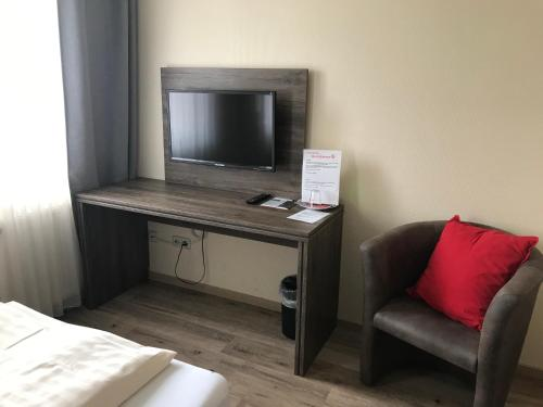 Een TV en/of entertainmentcenter bij Hotel Rahserhof