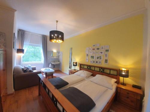 A bed or beds in a room at Pension Seeschlösschen