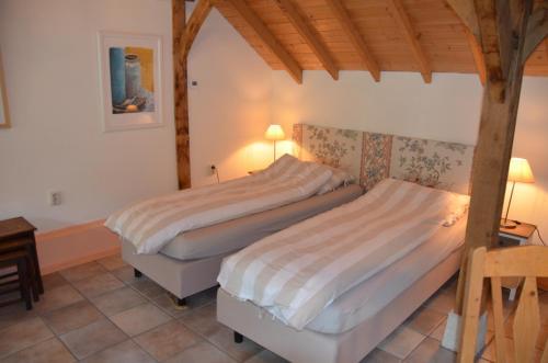 Een bed of bedden in een kamer bij Bed&Breakfast 't Eikeltje