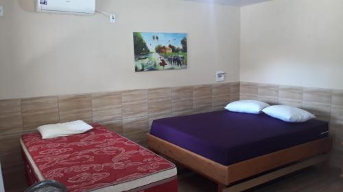 Cama ou camas em um quarto em Pousada Aruanã