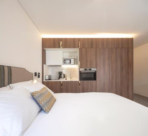 A bed or beds in a room at Lisbon Serviced Apartments - Avenida