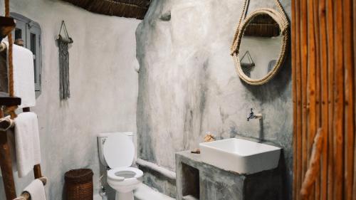 A bathroom at Papaya Playa Project