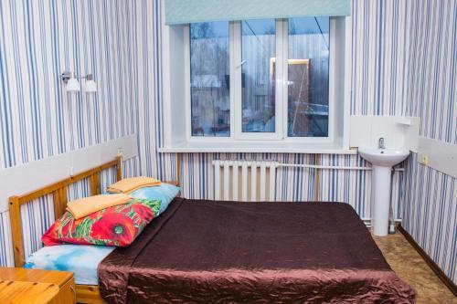 Кровать или кровати в номере Гостиница Телевышка