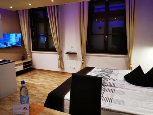 TV/Unterhaltungsangebot in der Unterkunft Apartmenthaus Wertheim