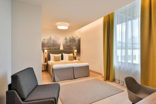 Vuode tai vuoteita majoituspaikassa Centennial Hotel Tallinn