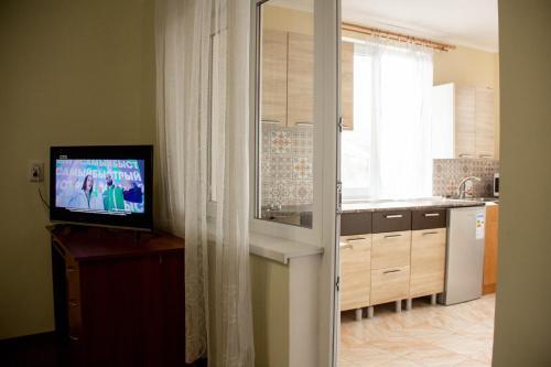 Телевизор и/или развлекательный центр в Тихий уютный дом