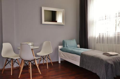 Łóżko lub łóżka w pokoju w obiekcie Teatr Baj Pomorski