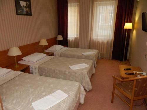 Кровать или кровати в номере Business Hotel