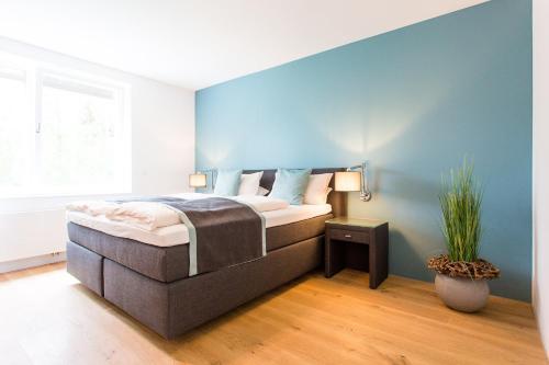 Ein Bett oder Betten in einem Zimmer der Unterkunft Hotel & Restaurant Gut Hungenbach