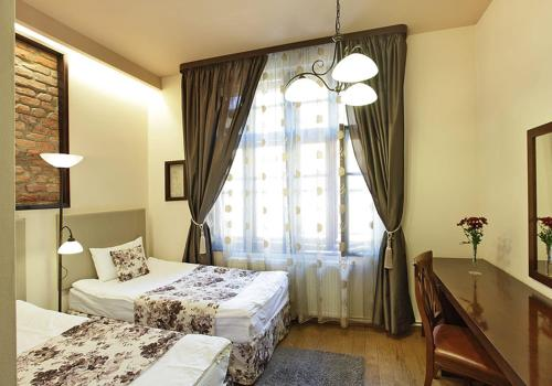 A bed or beds in a room at Casa Reims