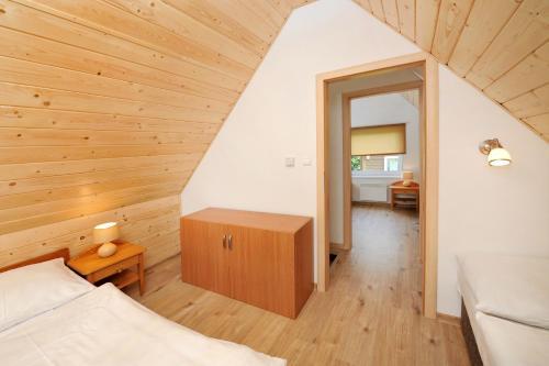 Posteľ alebo postele v izbe v ubytovaní APLEND Chaty Tatry Holiday